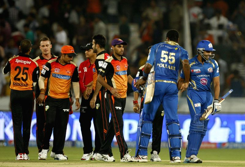 Mumbai Indians batsmen Rohit Sharma and Kieron Pollard shake hands with their opponents after winning 36th match of IPL 2014 between Sunrisers Hyderabad and Mumbai Indians at Rajiv Gandhi ... - Rohit Sharma