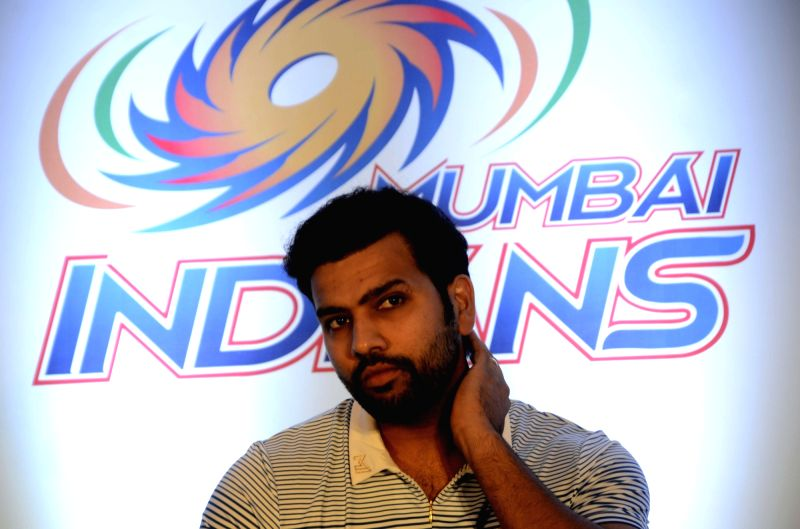 Mumbai Indians captain Rohit Sharma addresses a press conference  in Mumbai, on April 7, 2016. - Rohit Sharma