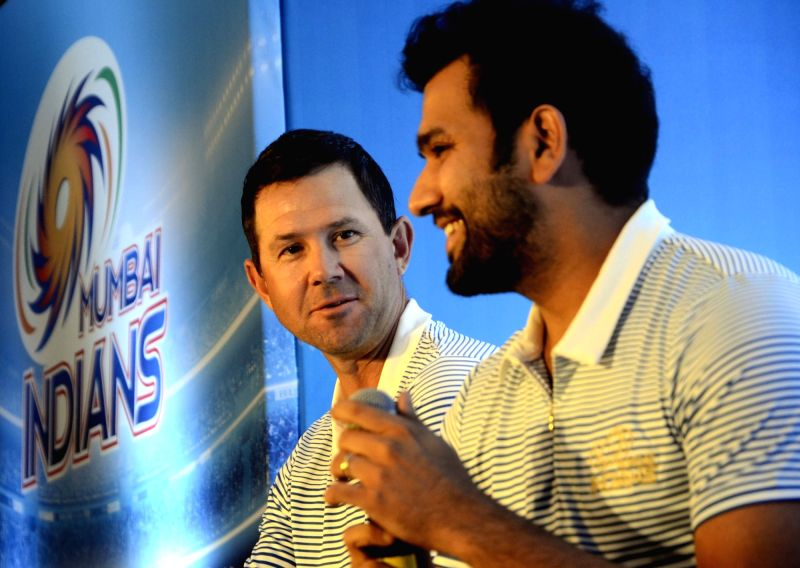 Mumbai Indians captain Rohit Sharma and head coach Ricky Ponting address a press conference  in Mumbai, on April 7, 2016. - Rohit Sharma