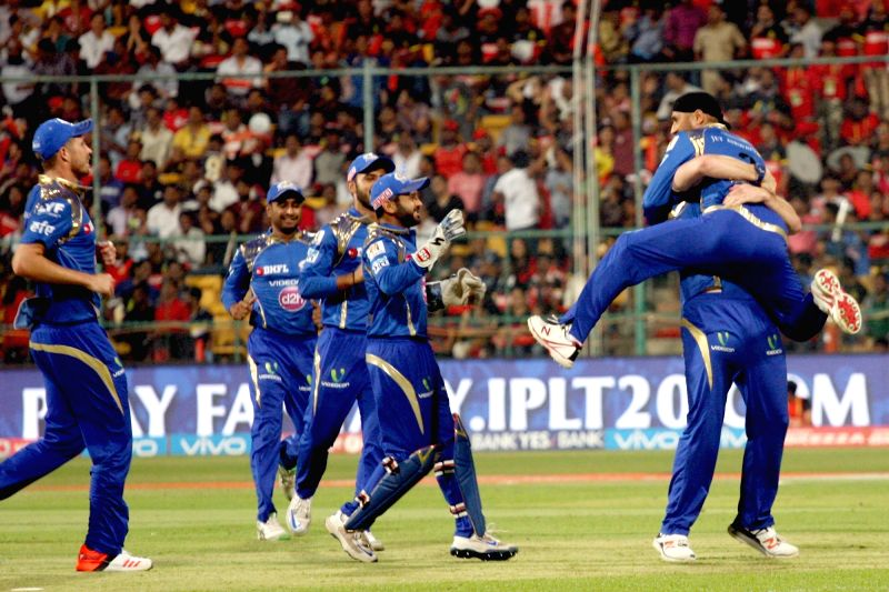Mumbai Indians celebrate fall of a wicket during an IPL match between Royal Challengers Bangalore and Mumbai Indians at M Chinnaswamy Stadium in Bengaluru on May 11, 2016.
