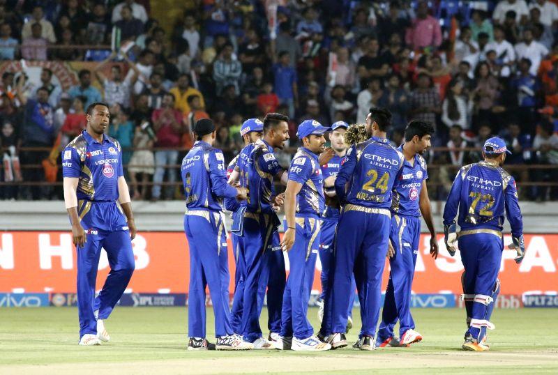 Mumbai Indians celebrate fall of a wicket during an IPL 2017 match between Gujarat Lions and Mumbai Indians at Saurashtra Cricket Association Stadium in Rajkot on April 29, 2017.
