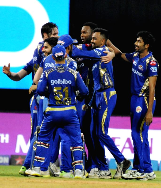 Mumbai Indians celebrate fall of Chris Gayle's wicket during an IPL 2018 match between Mumbai Indians and Kings XI Punjab at Wankhede Stadium in Mumbai, on May 16, 2018.