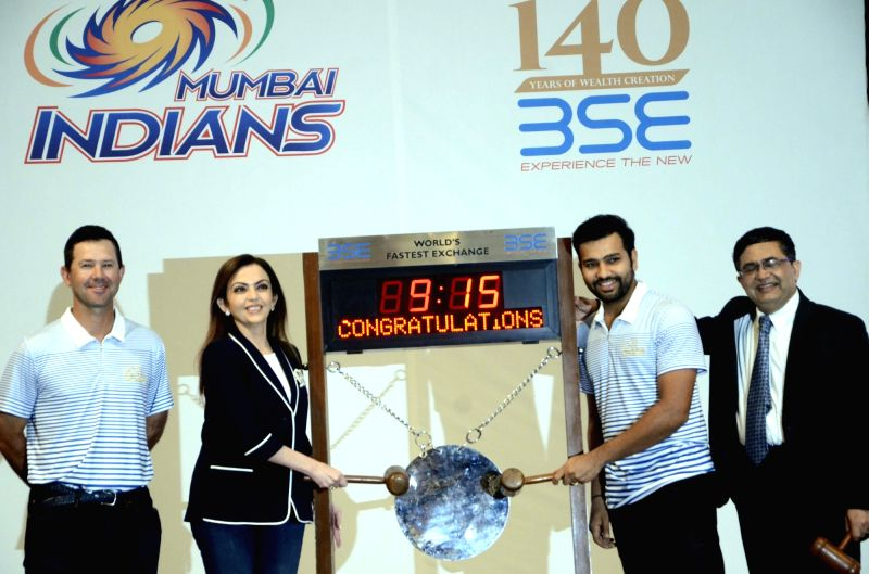 Mumbai Indians co-owner Nita Ambani, captain Rohit Sharma and head coach Ricky Ponting ring the opening bell of the Bombay Stock Exchange (BSE) in Mumbai, on April 7, 2016. - Rohit Sharma and Nita Ambani