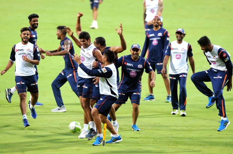 Mumbai Indians during a practice session at Chinnaswamy Stadium in Bengaluru on May 18, 2017.