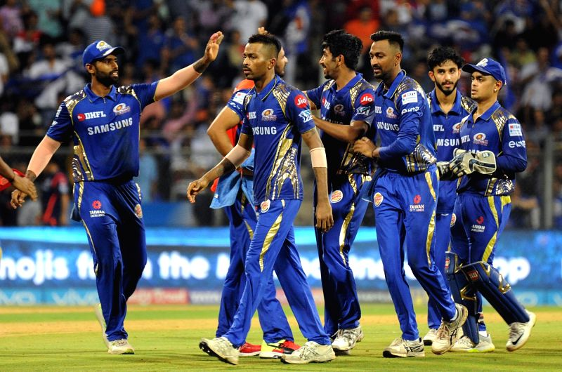 Mumbai Indians' Jasprit Bumrah celebrates fall of Aron Finch's wicket during an IPL 2018 match between Mumbai Indians and Kings XI Punjab at Wankhede Stadium in Mumbai, on May 16, 2018.