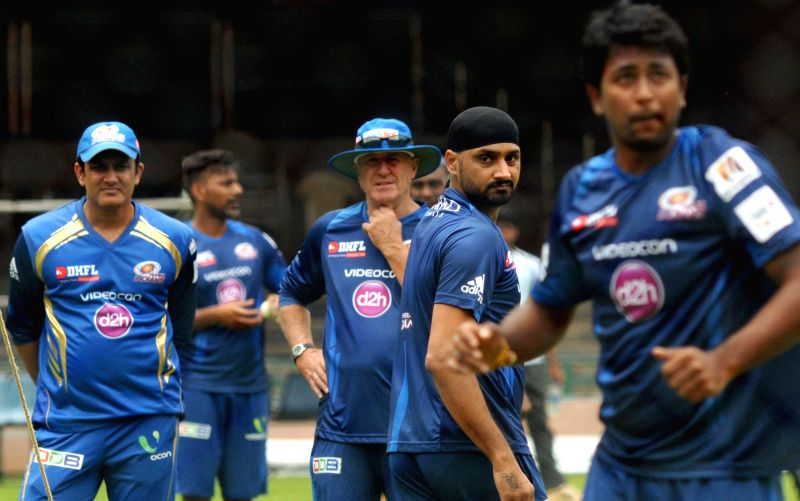 Mumbai Indians player Harbhajan Singh with Anil Kumble during a practice session ahead of Champions League in Bangalore on Sept 4, 2014. The venue of practice has been shifted to Bangalore due to ... - Harbhajan Singh