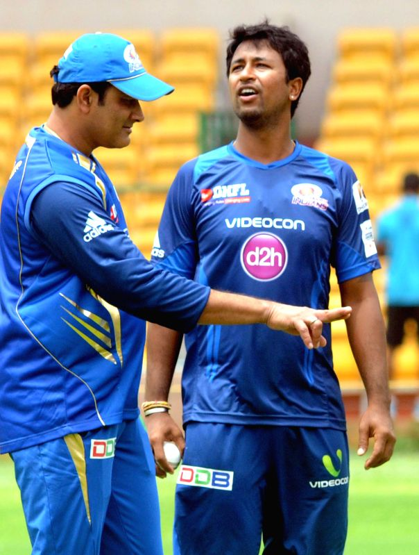 Mumbai Indians players Harbhajan Singh and Pragyan Ojha during a practice session ahead of Champions League in Bangalore on Sept 4, 2014. The venue of practice has been shifted to Bangalore due to ... - Harbhajan Singh