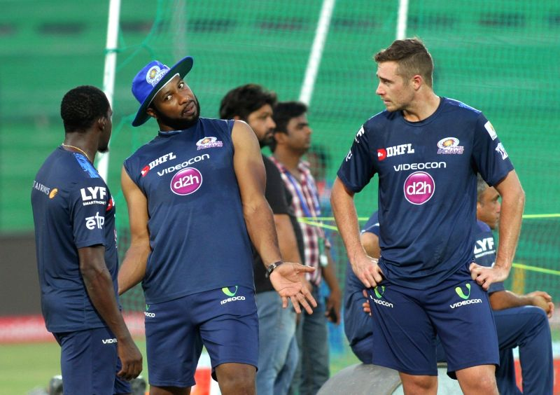 Mumbai Indians players Kieron Pollard and Tim Southee during a practice session at Green Park in Kanpur on May 20, 2016.