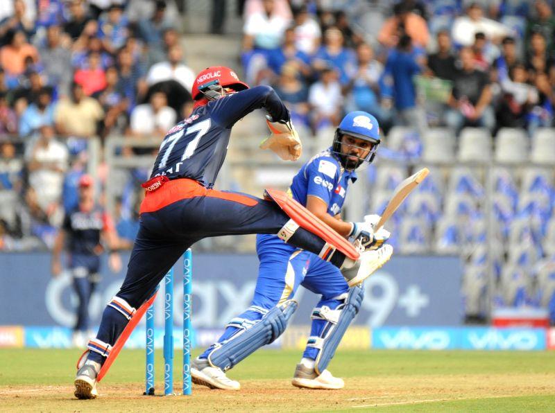 Mumbai Indians' skipper Rohit Sharma in action during an IPL 2018 match between Delhi Daredevils and Mumbai Indians at Wankhede Stadium in Mumbai on April 14, 2018. - Rohit Sharma