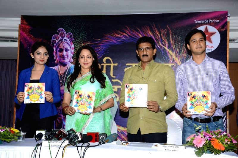 Jiney Batra ( Atharva), Hema Malini , Sunil Rane, Amit Gaur (Wizcraft) during the press conference to announce a two - day long Braj Mahotsav at Mathura, Vrindavan Chandrodaya Mandir on April ... - Hema Malini