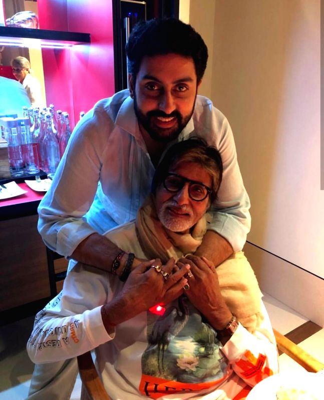"""Mumbai, June 13 (IANS) Bollywood veteran Amitabh Bachchan caught up with his latest release """"Gulabo Sitabo"""" on Friday at home with his entire family."""