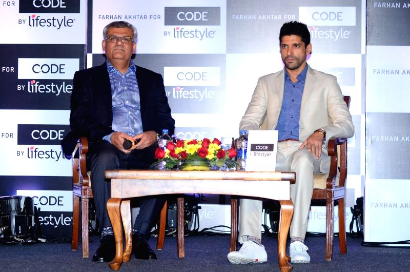 Kabir Lumba, MD, Lifestyle International Pvt Ltd with  actor Farhan Akhtar during the announcemen of brand ambassador for Code By Lifestyle in Mumbai on 18th March 2015