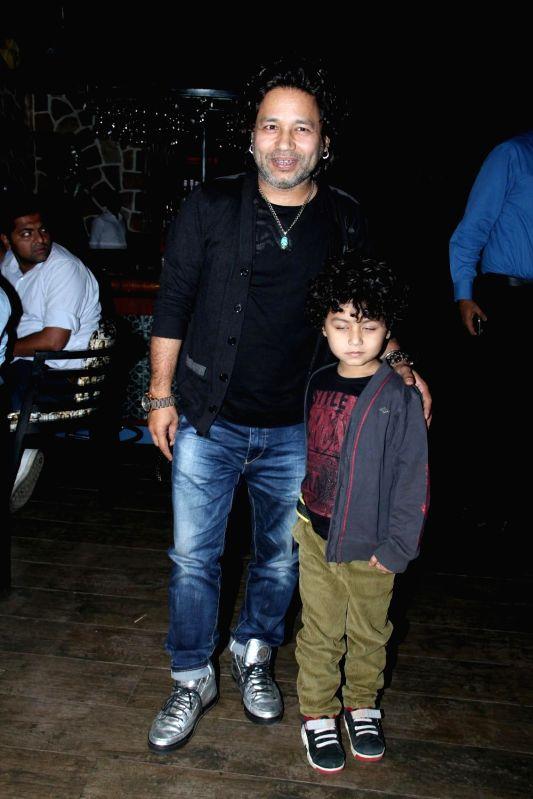 Kailash Kher celebrates selection in Oscar for movie Jal in Mumbai on Feb 25, 2015. - Kailash Kher
