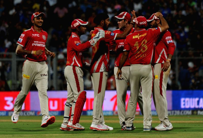 Kings XI Punjab players celebrate fall of a wicket during an IPL-2015 match between Mumbai Indians and Kings XI Punjab at Wankhede Stadium, in Mumbai, on April 12, 2015.