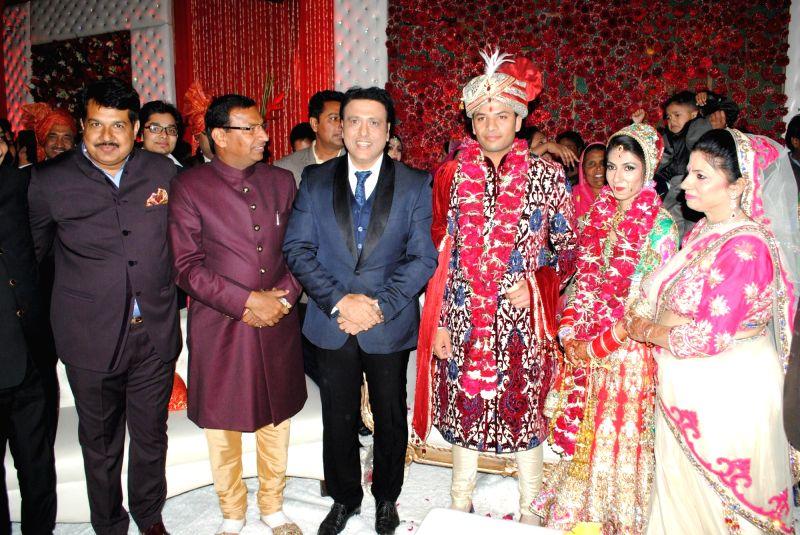 Krishan Choudhary (Bride's father), jai Karan Choudhary (Groom's father), Govinda, Atin and Lalita snapped at producer Krishna Choudhary's daughter's wedding in Mumbai on 12th February 2013 . - Krishan Choudhary and Karan Choudhary