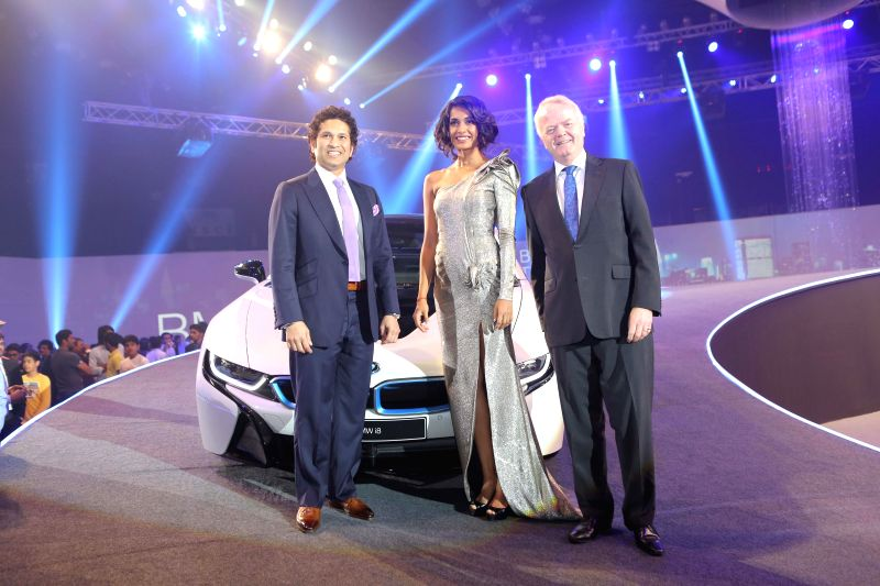 (L-R) Former Indian cricketer Sachin Tendulkar, Sarah-Jane Dias and Mr. Philipp von Sahr during the launch of BMW i8 hybrid sports car in Mumbai on February 18, 2015. - Sachin Tendulkar and Sarah-Jane Dias