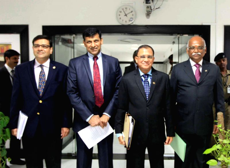 (L - R)  RBI Deputy Governor Urjit Patel, Governor Raghuram Rajan, Deputy Governors H R Khan and R Gandhi arrive for the press conference to announce the RBI monetary policy at RBI head ... - Urjit Patel and R Gandhi