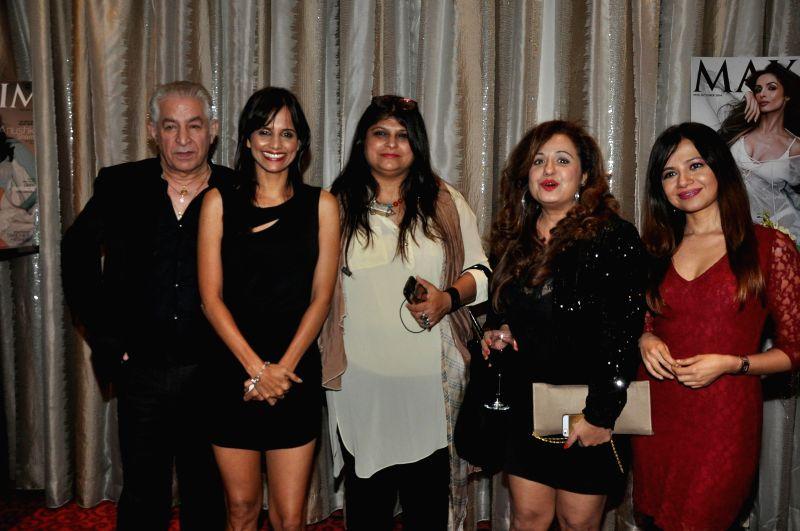 (L to R) Dalip Tahil, Nisha Harale, Sonia Desai, Vandana Sajnani Khattar and Natasha Singh during the Grand Finale of Miss Maxim 2015 in Mumbai on Dec 21, 2014. - Sonia Desai, Vandana Sajnani Khattar and Natasha Singh