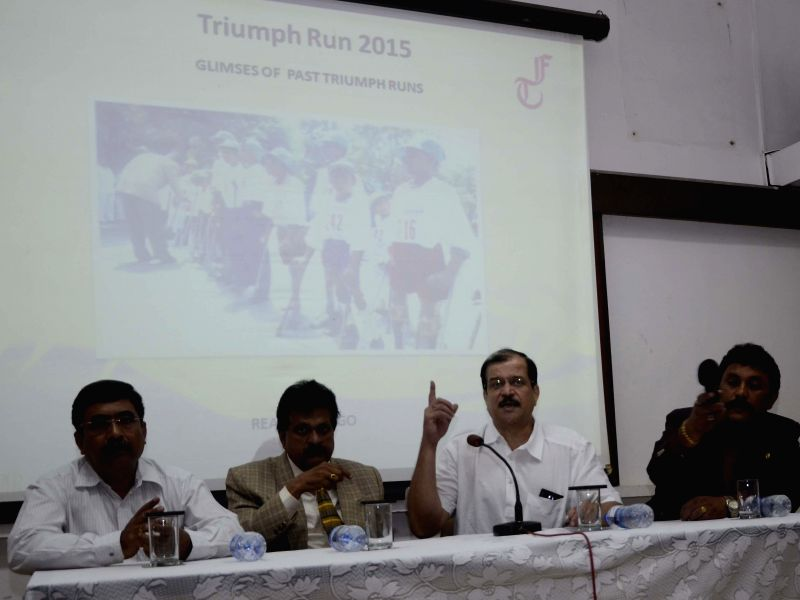 (L to R) Shirish Songadhkar, K S Ranganathan, Dilip Damle with Anil Shinde address a press conference regarding ``Triumph Run 2015`` which will commence from Holy Cross Convent School Ground,