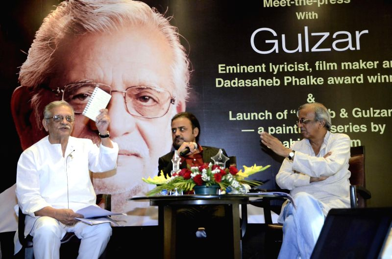 Lyricist and film maker Gulzar during the launch of a ``Ghalib and Gulzar`` paintings` series by Shahid Rassam, an internationally known Pakistani artist at Mumbai Press Club in Mumbai on ...
