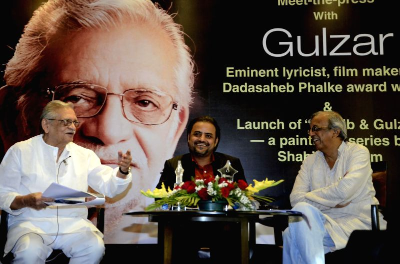 Lyricist and film maker Gulzar during the launch of a ``Ghalib and Gulzar`` paintings` series by Shahid Rassam, an internationally known Pakistani artist at Mumbai Press Club in Mumbai on ...