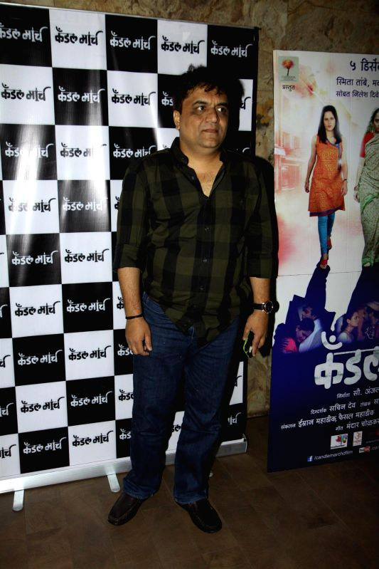 Lyricist  Swanand Kirkire during special screening of Marathi film Candle March in Mumbai  in Mumbai on Dec 4, 2014.