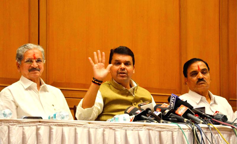 Maharashtra Chief Minister Devendra Fadnavis during a press conference with Shiv Sena leaders Subhas Desai and Divakar Ravate in Mumbai, on Dec 4, 2014. - Devendra Fadnavis and Subhas Desai