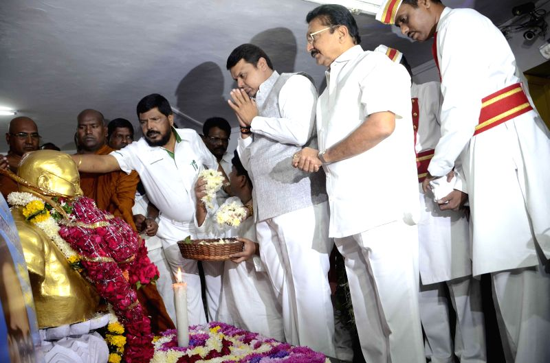 Maharashtra Chief Minister Devendra Fadnavis with other leaders offering floral tribute at the statue of Baba Saheb Dr. BR Ambedkar on the occasion of his `Mahaparinirvan Diwas` in Mumbai on . - Devendra Fadnavis