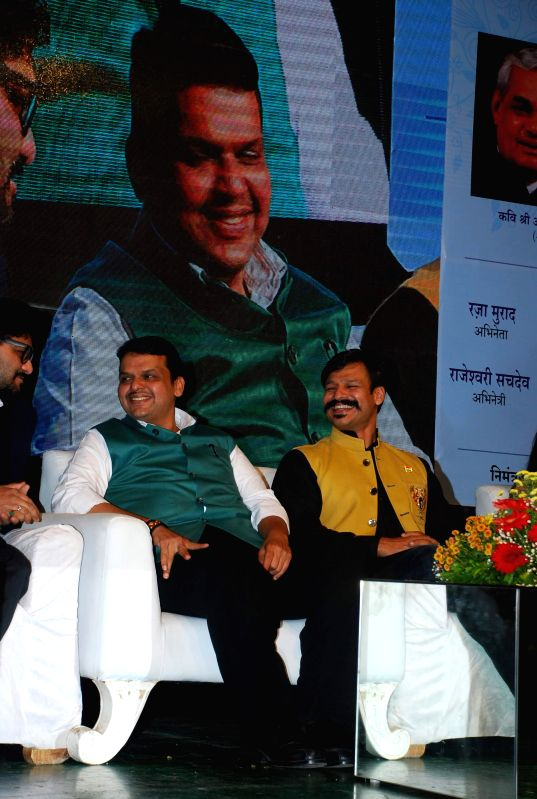 Maharashtra Chief Minister Devendra Fadnavis and actor Vivek Oberoi during Atal Geet Ganga a poetic eve to celebrate former Prime Minister Atal Bihari Vajpayee`s 90th birthday in Mumbai, on .. - Devendra Fadnavis