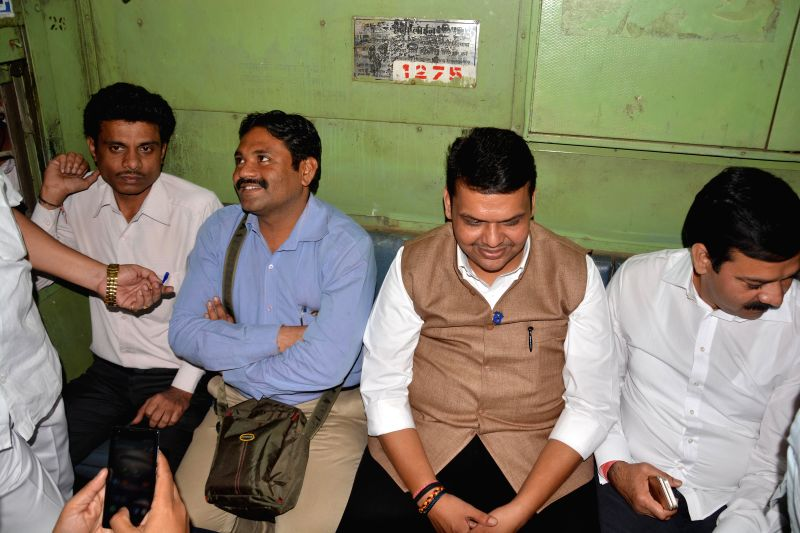 Maharashtra Chief Minister Devendra Fadnavis travels in a suburban train in Mumbai, on Dec 29, 2014.