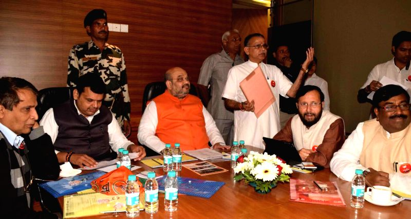 Maharashtra Chief Minister Devendra Fadnavis, BJP chief Amit Shah, Union Railway Minister Suresh Prabhu, Union Minister of State for Environment, Forest and Climate Change (Independent ... - Devendra Fadnavis, Suresh Prabhu and Amit Shah