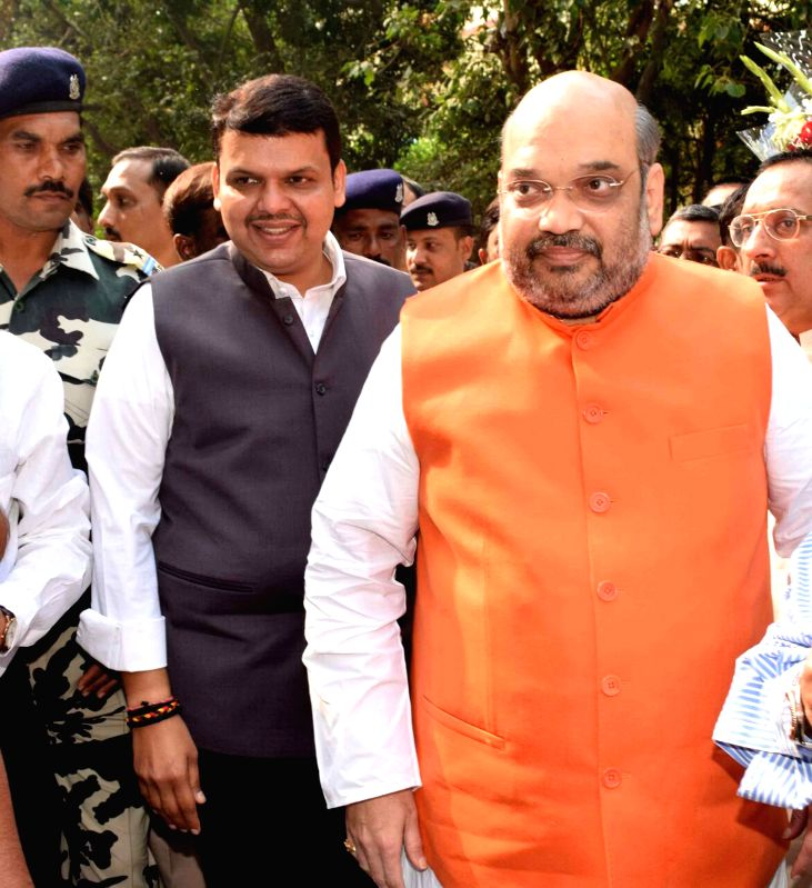 Maharashtra Chief Minister Devendra Fadnavis and BJP chief Amit Shah arrive to attend a meeting in Mumbai on Jan 2,2014. - Devendra Fadnavis and Amit Shah