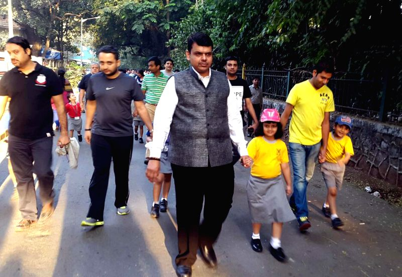 Maharashtra Chief Minister Devendra Fadnavis with his daughter at Kamala Park, Mumbai on Jan 14, 2015. - Devendra Fadnavis