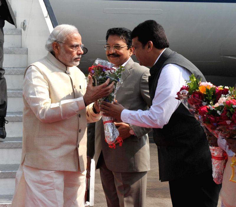 Maharashtra Chief Minister Devendra Fadnavis and Maharashtra Governor Chennamaneni Vidyasagar Rao greet  Prime Minister Narendra Modi on his arrival at Mumbai Airport on Jan 18, 2015. - Devendra Fadnavis, Narendra Modi and Chennamaneni Vidyasagar Rao