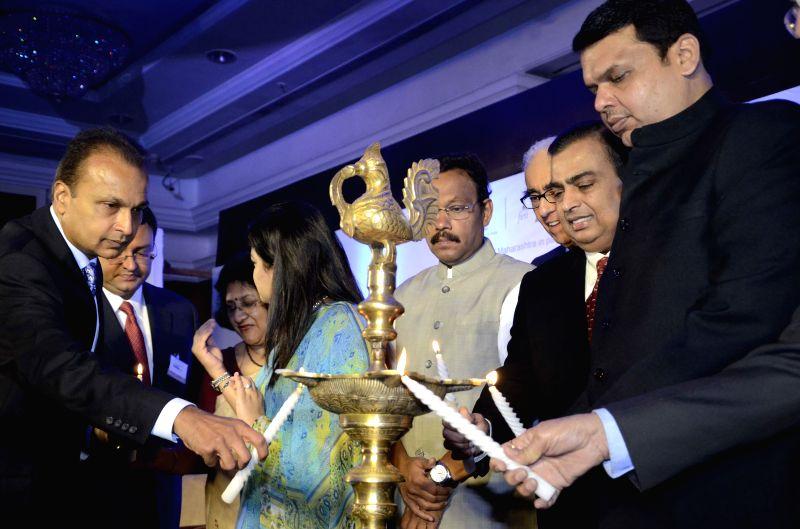 Maharashtra Chief Minister Devendra Fadnavis, Reliance ADAG chairman Anil Ambani, Reliance Industries Ltd (RIL) Chairman Mukesh Ambani, SBI Chairman Arundhati Bhattacharya and Tata group ... - Devendra Fadnavis and Mukesh Ambani