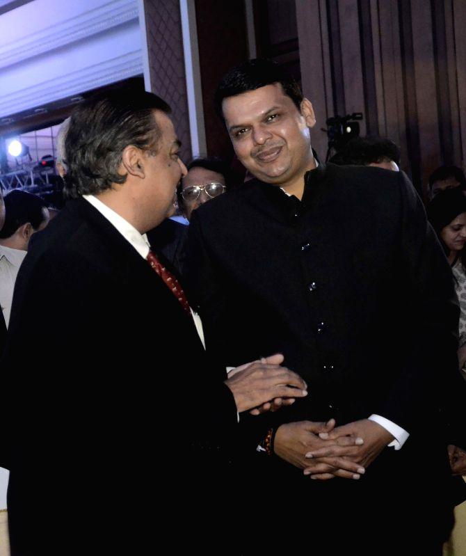 Maharashtra Chief Minister Devendra Fadnavis with Reliance Industries Ltd (RIL) Chairman Mukesh Ambani at the inauguration of `Mumbai Next` conclave in Mumbai, on Feb 6, 2015. - Devendra Fadnavis and Mukesh Ambani