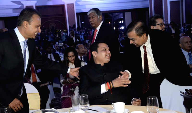 Maharashtra Chief Minister Devendra Fadnavis with Reliance Industries Ltd (RIL) Chairman Mukesh Ambani and Reliance ADAG chairman Anil Ambani at the inauguration of `Mumbai Next` conclave in . - Devendra Fadnavis and Mukesh Ambani