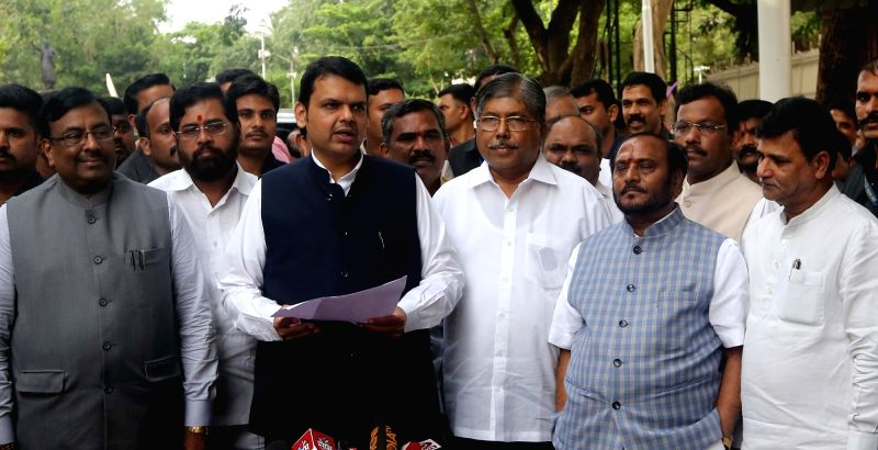 : Mumbai: Maharashtra Chief Minister Devendra Fadnavis along with party leaders interact with the media after an all-party meeting to discuss the Maratha reservation issue, in Mumbai on July 28, ...
