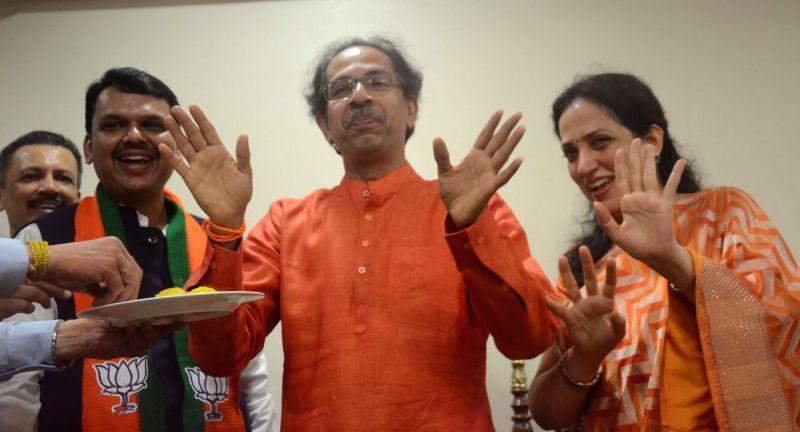 Mumbai: Maharashtra Chief Minister Devendra Fadnavis, Shiv Sena chief Uddhav Thackeray and his wife Rashmi Thackeray celebrate as the BJP-led NDA is set to retain power for another five years after making a sweep of the 2019 Lok Sabha battle and maul