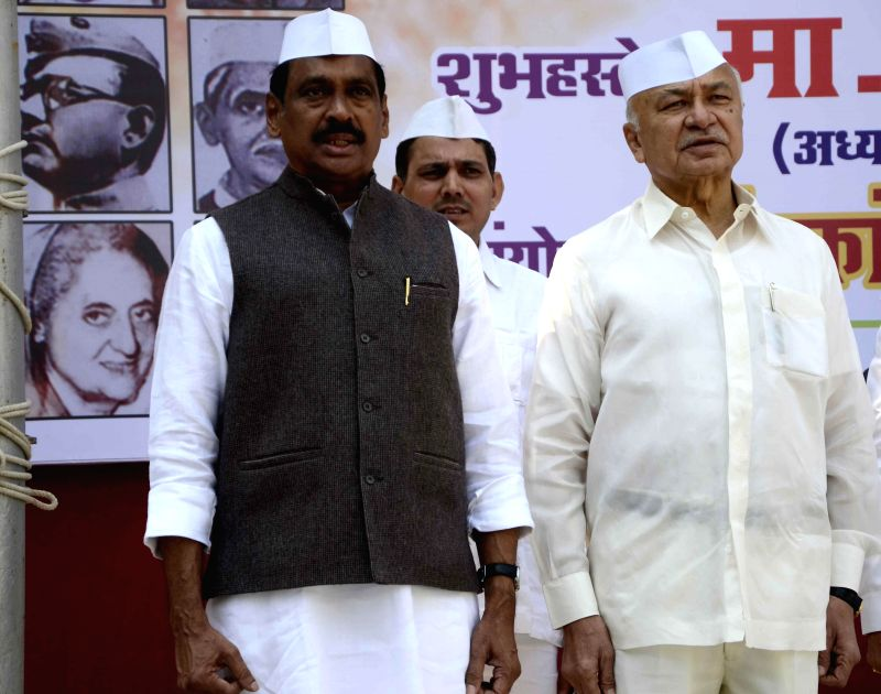 Maharashtra Congress chief Manikrao Thakre and party leader Sushil Kumar Shinde 129th Foundation Day of the party in Mumbai on Dec 27, 2014. - Sushil Kumar Shinde