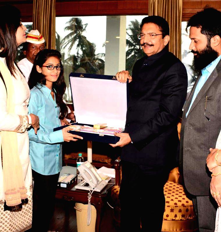 Maharashtra Governor C. Vidyasagar Rao felicitates Mariyam Asif Siddiqui who won first prize in the Gita Champions League competition conducted by ISKCON at Raj Bhavan in Mumbai on April 8, ... - C. Vidyasagar Rao