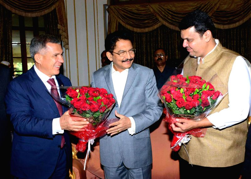 Maharashtra Governor Chennamaneni Vidyasagar Rao and Maharashtra Chief Minister Devendra Fadnavis with President of Tatarstan Rustam Minnikhanov at Raj Bhavan in Mumbai, on Nov 19, 2014. - Devendra Fadnavis and Chennamaneni Vidyasagar Rao