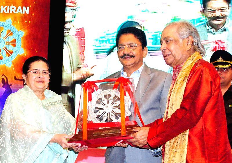 Maharashtra Governor Chennamaneni Vidyasagar Rao presents  Aditya Vikram Birla Kala Shikhar Award to renowned exponent of the Kathak dance Pandit Birju Maharaj during a programme in Mumbai on - Chennamaneni Vidyasagar Rao