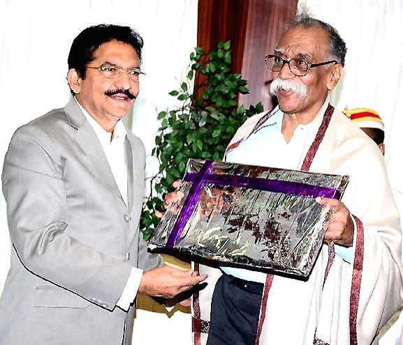 Maharashtra Governor Chennamaneni Vidyasagar Rao felicitates Marathi writer Bhalchandra Vanaji Nemade at Raj Bhawan on Feb 15, 2015. - Chennamaneni Vidyasagar Rao