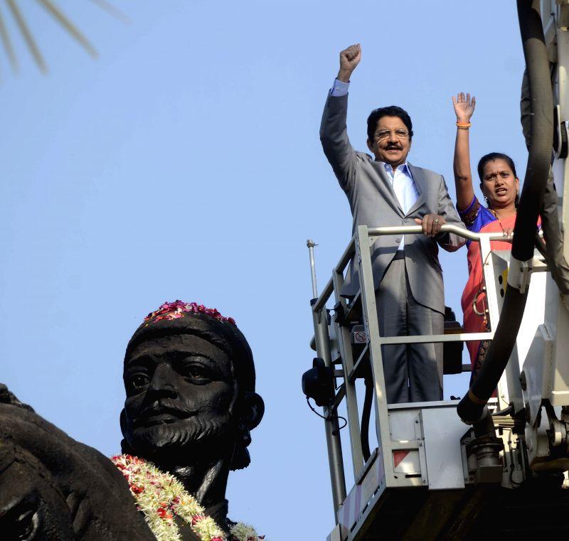 Maharashtra Governor Chennamaneni Vidyasagar Rao and Mumbai Mayor Snehal Ambekar pays tribute to Chatrapati Shivaji on his birth anniversary  in Mumbai, on Feb 19, 2015. - Chennamaneni Vidyasagar Rao