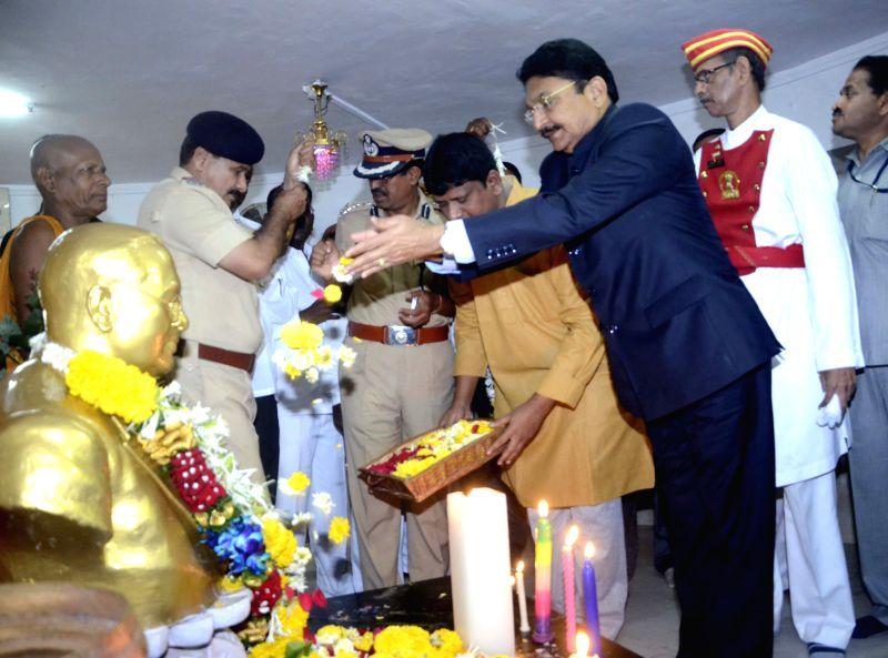 Maharashtra Governor Chennamaneni Vidyasagar Rao pays tribute to Dr. B. R. Ambedkar at Chaitya Bhoomi in Mumbai on April 14, 2015. - Chennamaneni Vidyasagar Rao
