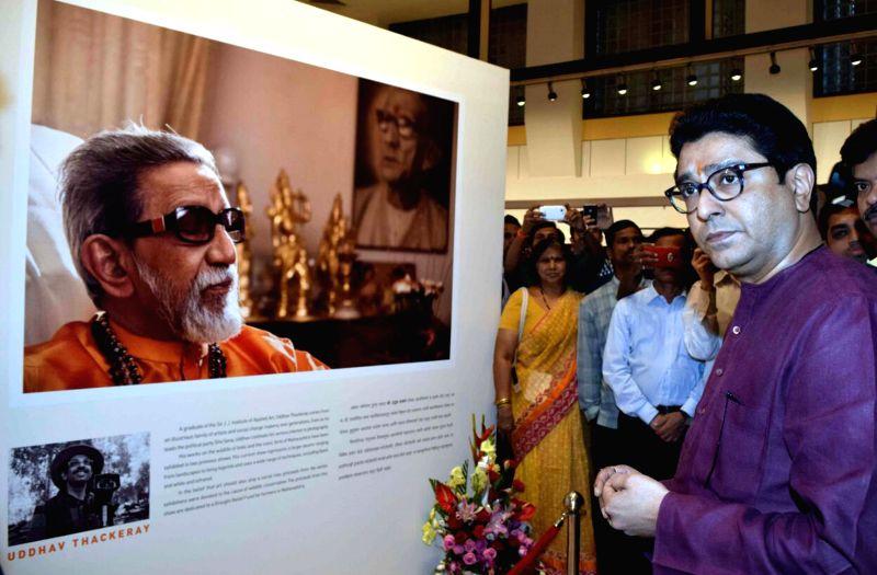 Maharashtra Navnirman Sena (MNS) chief Raj Thackeray  at the photography exhibition of Shiv Sena Chief Uddhav Thackeray, organised to raise funds for drought affected farmers, in Mumbai, on ..