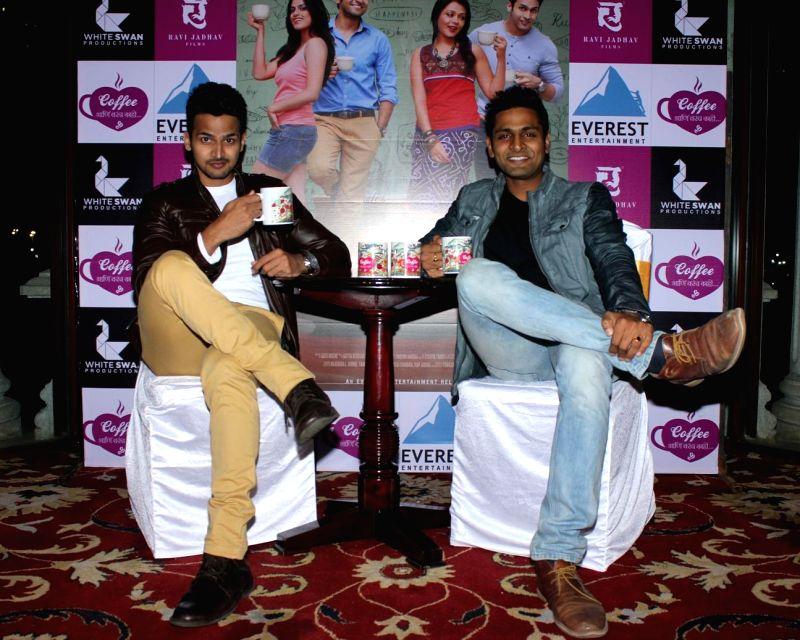 Marathi actors Bushan Pradhan and Vaibhav Tatwawadi during the music launch of Marathi film Coffee Ani Barach Kahi in Mumbai, on March 10, 2015. - Bushan Pradhan and Vaibhav Tatwawadi
