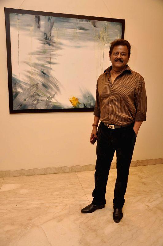 Marathi film actor Ramesh Bhatkar during Bollywood actor Amol Palekar's painting exhibition, in Mumbai on Nov 25, 2014. - Ramesh Bhatkar