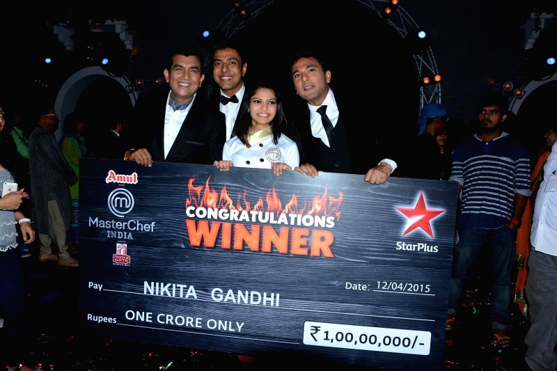 MasterChef India season 4 winner Nikita Gandhi with the judges Sanjeev Kapoor, Vikas Khanna and Ranveer Brar at the grand finale of ``MasterChef India 4`` in Mumbai on April 12, 2015. - Nikita Gandhi, Sanjeev Kapoor and Vikas Khanna
